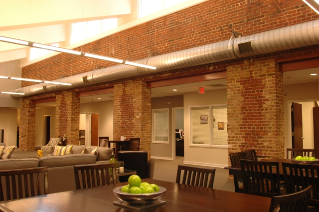"""2nd Floor Open Area.  16"""" thick brick walls found behind sheetrock were repaired and left exposed"""