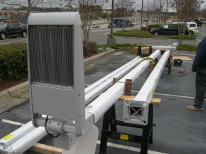 A CREE LED pole light fixture is prepared prior to installation during a parking lot energy upgrade.