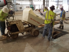 Concrete buggy dumps concrete at paint booth ventilation pits