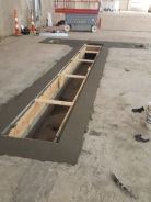 Paint booth ventilation pit concrete tie-in poured