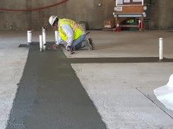 Concrete slab tie-ins troweled at plumbing rough-in