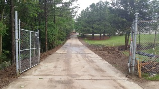 Cleanup underway along entrance drive