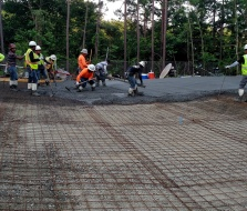 Reinforcing mesh on top of compacted gravel on top of geotech fabric