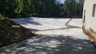 Rear driveway and parking area pavement complete