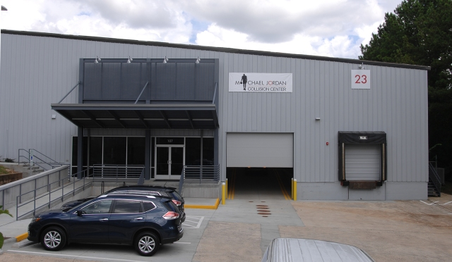 Michael Jordan Collision Center - Renovated Front entrance area with canopy and at-grade access