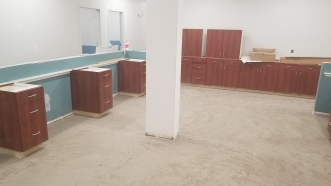 Flooring prep complete at central workstation area